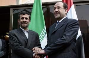 ahmadinejad and maliki photo ahmad al rabaye afp