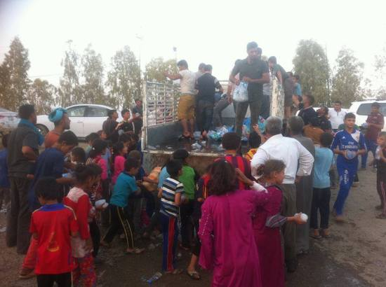 Turkmen refugee children water