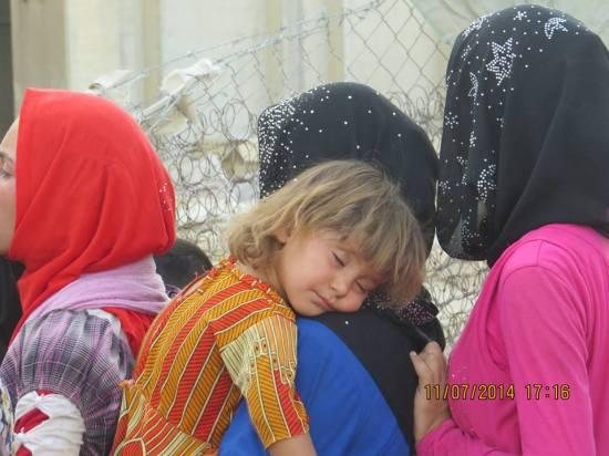 Turkmen refugee, mother with sick child